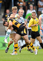 High Wycombe, England. Shane Geraghty of London Irish tackled by Andrea Masi of London Wasps during the Aviva Premiership match between London Wasps and London Irish at Adams Park on September,15 2012 in High Wycombe, England.