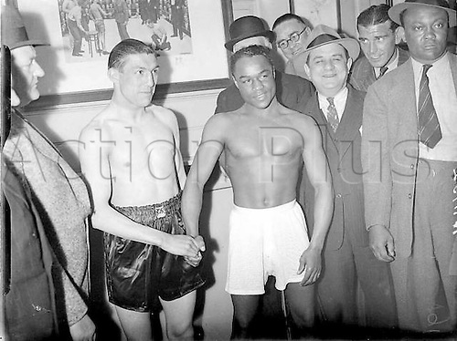 25.05.1939. Harringay, London England. At the weigh-in for their Harringay fight , Ernie Roderick and Henry Armstrong. 25th May 1939