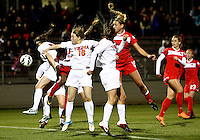 BOYDS, MARYLAND - April 06, 2013:  Olivia Wagner (12) of The Washington Spirit heads past the defense of the University of Virginia women's soccer team in a NWSL (National Women's Soccer League) pre season exhibition game at Maryland Soccerplex in Boyds, Maryland on April 06. Virginia won 6-3.