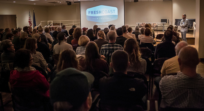 Filmmaker Brian Kauffman engages with the audience following his film Predator/Prey at the Fresh Coast Film Festival in Marquette, Michigan. The festival, held annually in October, celebrates the outdoor lifestyle and environment of the Great Lakes region.