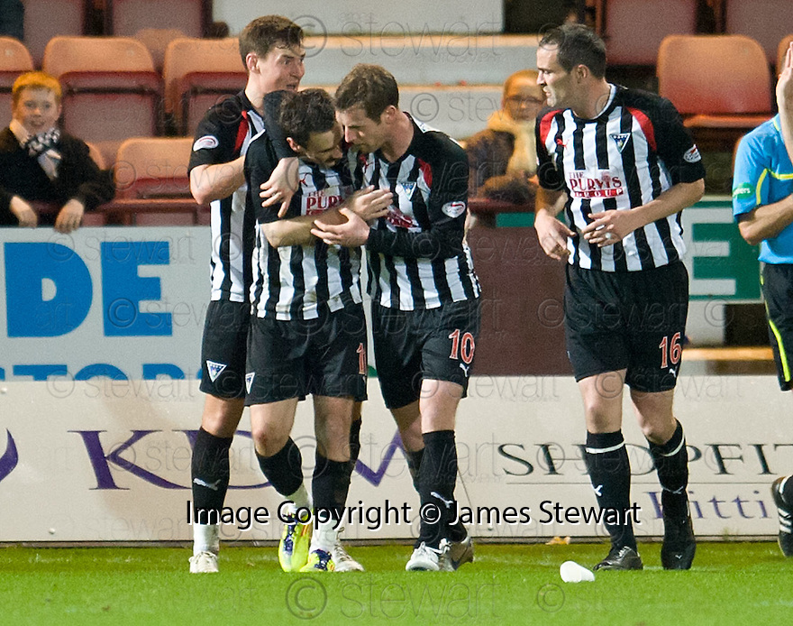 PARS DAVID GRAHAM IS CONGRATULATED AFTER HE SCORES DUNFERMLINE'S SECOND GOAL