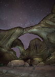 Stars over the light-painted Double Arch