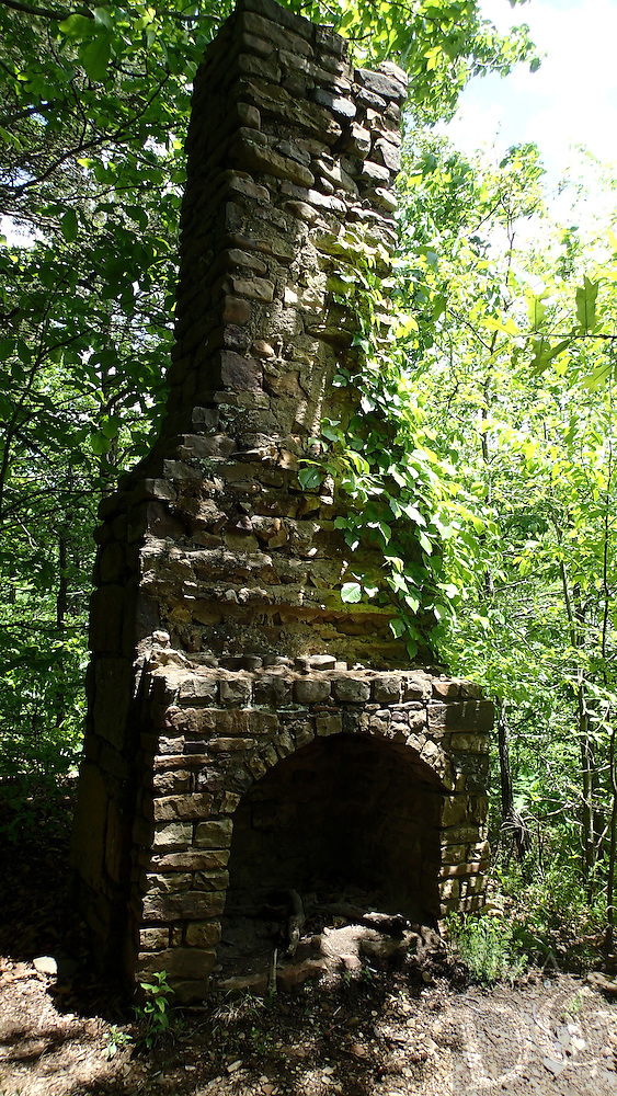 NWA Democrat-Gazette/FLIP PUTTHOFF <br /> Two chimneys, the remnants of homesteads, are seen April 27, 2016 along the Ozark Highlands Trail at Lake Fort Smith State Park.