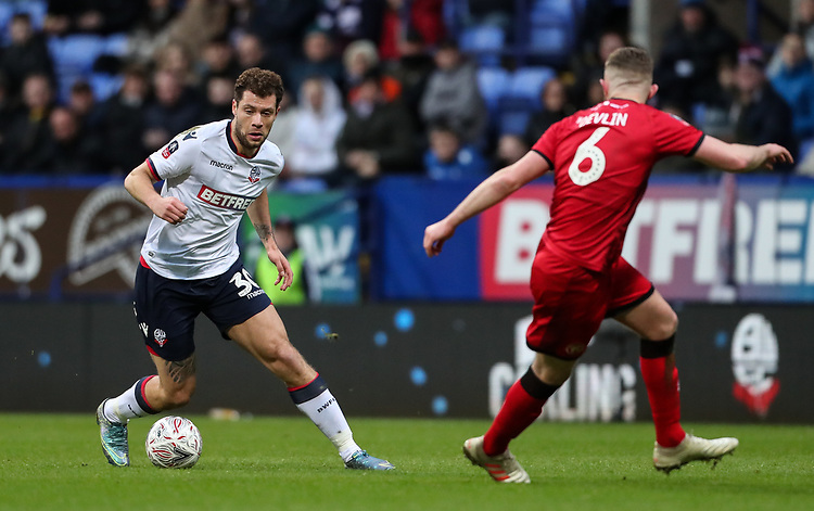 Bolton Wanderers' Yanic Wildschut competing with Walsall's Nicky Devlin<br /> <br /> Photographer Andrew Kearns/CameraSport<br /> <br /> Emirates FA Cup Third Round - Bolton Wanderers v Walsall - Saturday 5th January 2019 - University of Bolton Stadium - Bolton<br />  <br /> World Copyright © 2019 CameraSport. All rights reserved. 43 Linden Ave. Countesthorpe. Leicester. England. LE8 5PG - Tel: +44 (0) 116 277 4147 - admin@camerasport.com - www.camerasport.com