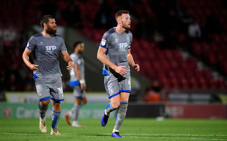 Lincoln City's Michael Bostwick, left, and Lincoln City's Cian Bolger<br /> <br /> Photographer Chris Vaughan/CameraSport<br /> <br /> EFL Leasing.com Trophy - Northern Section - Group H - Doncaster Rovers v Lincoln City - Tuesday 3rd September 2019 - Keepmoat Stadium - Doncaster<br />  <br /> World Copyright © 2018 CameraSport. All rights reserved. 43 Linden Ave. Countesthorpe. Leicester. England. LE8 5PG - Tel: +44 (0) 116 277 4147 - admin@camerasport.com - www.camerasport.com