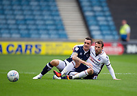 Bolton Wanderers' Adam Le Fondre battles for possession with Millwall's Shaun Williams<br /> <br /> Photographer Ashley Western/CameraSport<br /> <br /> The EFL Sky Bet Championship - Millwall v Bolton Wanderers - Saturday August 12th 2017 - The Den - London<br /> <br /> World Copyright &copy; 2017 CameraSport. All rights reserved. 43 Linden Ave. Countesthorpe. Leicester. England. LE8 5PG - Tel: +44 (0) 116 277 4147 - admin@camerasport.com - www.camerasport.com