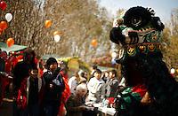 Traditional Vietnamese dancers perform as a spectator photographs them during an Asian New Year festival, Sunday, Jan. 25, 2009, at Lien Hoa Buddhist temple in San Antonio. (Darren Abate/pressphotointl.com)