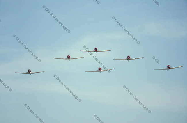 Photo of North American AT-6 Fighter Trainer WW2 airplanes in Flight.