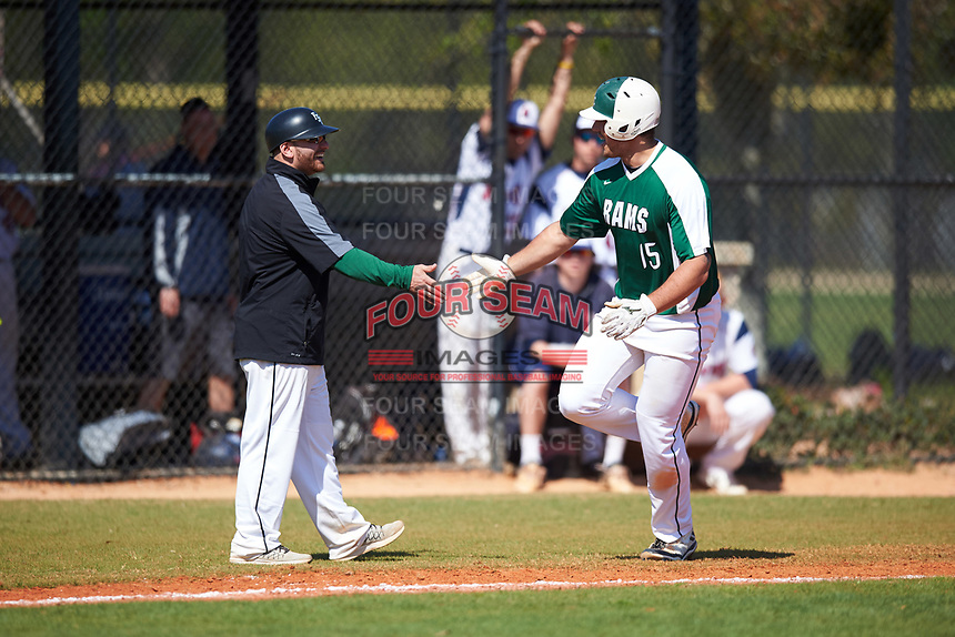 Farmingdale State Rams third base coach Anthony Alvino (left) congratulates Dalton McCarthy (15) after a home run during the first game of a doubleheader against the FDU-Florham Devils on March 15, 2017 at Lake Myrtle Park in Auburndale, Florida.  Farmingdale defeated FDU-Florham 6-3.  (Mike Janes/Four Seam Images)