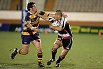 Tevita Tuifua  fends off Simms Davison during the Air NZ Cup rugby game between Bay of Plenty & Counties Manukau played at Blue Chip Stadium, Mt Maunganui on 16th of September, 2006. Bay of Plenty won 38 - 11.