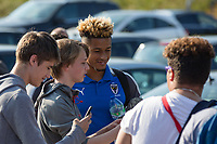 Lyle Taylor of AFC Wimbledon signs for fans ahead of the Friendly match between Wycombe Wanderers and AFC Wimbledon at Adams Park, High Wycombe, England on 25 July 2017. Photo by Andy Rowland.