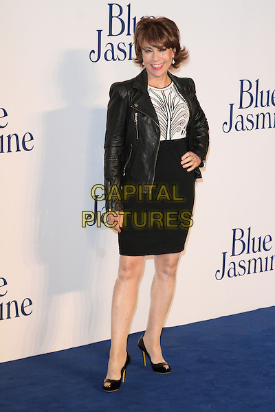 Kathy Lette<br /> UK Premiere of 'Blue Jasmine' at the Odeon West End, Leicester Square. London, England.<br /> 17th September 2013<br /> full length black jacket leather white dress skirt top hand on hip<br /> CAP/ROS<br /> &copy;Steve Ross/Capital Pictures
