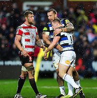 Chris Cook of Bath Rugby is congratulated on his try by team-mate Dominic Day. Aviva Premiership match, between Gloucester Rugby and Bath Rugby on March 26, 2016 at Kingsholm Stadium in Gloucester, England. Photo by: Patrick Khachfe / Onside Images