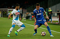Mario Mandzukic  Faouzi Ghoulam  during the  italian serie a soccer match,between SSC Napoli and Juventus       at  the San  Paolo   stadium in Naples  Italy , April 02, 2017