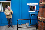 A spectator paying in to the Harry Williams Riverside Stadium, home to Ramsbottom United before they played Barwell in a Northern Premier League premier division match. This was the club's 13th league game of the season and they were still to record their first victory following a 3-1 defeat, watched by a crowd of 176. Rams bottom United were formed by Harry Williams, the current chairman, in 1966 and progressed from local amateur football  in Bury to the semi-professional leagues.