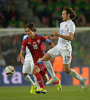 PRAGUE, Czech Republic - September 3, 2014: USA's Mix Diskerud and Tomas Rosicky of the Czech Republic during the international friendly match between the Czech Republic and the USA at Generali Arena.
