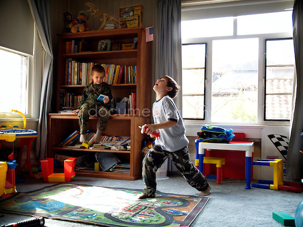 Two kids playing in their room.