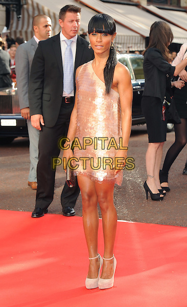 "JADA PINKETT-SMITH.The Gala Premiere of ""The Karate Kid"", Odeon Leicester Square, London, England, UK..15th July 2010.full length fringe bangs ponytail hair up pink one shoulder beige shiny paillettes dress discs cream white ankle strap shoes .CAP/BEL.©Tom Belcher/Capital Pictures."