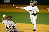 Wake Forest Demon Deacons shortstop Pat Blair #11 turns a double play as Jose Brizuela #53 of the Florida State Seminoles slides into second base at Wake Forest Baseball Park on March 24, 2012 in Winston-Salem, North Carolina.  The Seminoles defeated the Demon Deacons 3-2.  (Brian Westerholt/Four Seam Images)