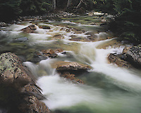 Water cascades through a rocky section of the South Fork Snoqualmie River, Snoqualmie Pass, Cascade Mountains, Washington State