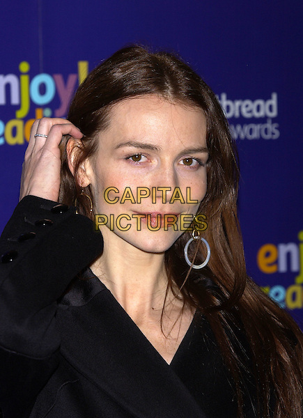 SAFFRON BURROWS.Whitbread Book of the Year Award 2004, The Brewery, Chiswell Street, London, January 25th 2005..portrait headshot touching hair ring earrings circle hoop dangly.Ref: PL.www.capitalpictures.com.sales@capitalpictures.com.©Capital Pictures.