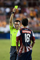 CD Guadalajara midfielder Edgar Solis (16) receives a yellow card caution in the 88th minute from referee Enrico Wijngaarde.  CD Guadalajara defeated Houston Dynamo 1-0 during the group stage of the Superliga 2008 tournament at Robertson Stadium in Houston, TX on July 15, 2008.