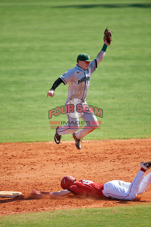 Dartmouth Big Green second baseman Sean Sullivan (4) jumps for a throw as Brendan Dougherty (26) slides in during a game against the Bradley Braves on March 21, 2019 at Chain of Lakes Stadium in Winter Haven, Florida.  Bradley defeated Dartmouth 6-3.  (Mike Janes/Four Seam Images)