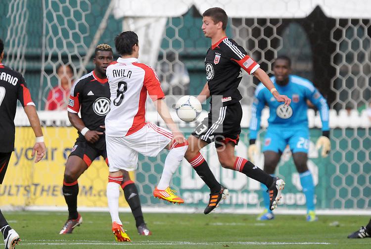 D.C. United midfielder Perry Kitchen (23) goes against Toronto FC midfielder Eric Avila (8) D.C. United defeated Toronto FC 3-1 at RFK Stadium, Saturday May 19, 2012.