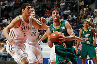 01.04.2012 SPAIN - ACB match played between Real Madrid vs Unicaja  at Palacio de los deportes stadium. The picture show Nicola Mirotic (Spanish/Montenegran power forward of Real Madrid) and Berni Rodriguez (Unicaja)