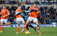 Oliver Lee of Luton Town & Alex Lawless (right) of Luton Town stop a Aaron Pierre of Wycombe Wanderers attack during the Sky Bet League 2 match between Wycombe Wanderers and Luton Town at Adams Park, High Wycombe, England on 6 February 2016. Photo by Andy Rowland.