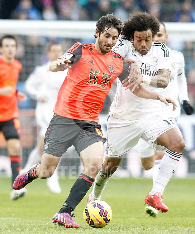 Real Madrid's Marcelo Vieira (r) and Real Sociedad's Esteban Granero during La Liga match.January 31,2015. (ALTERPHOTOS/Acero)