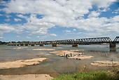 Pirapora, Minas Gerais, Brazil. The Marechal Hermes bridge over the Sao Francisco river with women washing clothes.