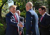"United States President Donald J. Trump, left, shakes hands with General John W. ""Jay"" Raymond, Commander, Air Force Space Command, center, as he announces he is establishing the US Space Command in the Rose Garden of the White House in Washington, DC on Thursday, August 29, 2019.  The Space Command will be the lead military agency for the planning and execution of space operations and will be a step towards establishing a Space Force as a new military service.  At right is US Secretary of Defense Dr. Mark T. Esper.<br /> Credit: Ron Sachs / Pool via CNP"