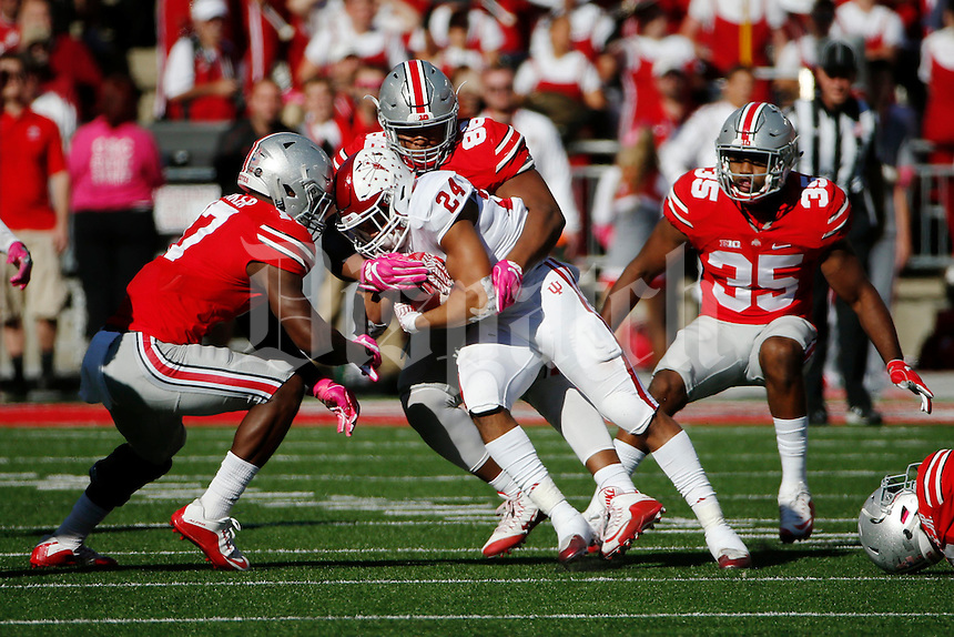 Ohio State Buckeyes defensive lineman Dre'Mont Jones (86) brings down Indiana Hoosiers running back Mike Majette (24) during the first quarter of a NCAA Division I college football game between the Ohio State Buckeyes and the Indiana Hoosiers on Saturday, October 8, 2016 at Ohio Stadium in Columbus, Ohio. (Joshua A. Bickel/The Columbus Dispatch)