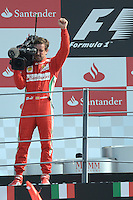 09.09.2012. Monza, Italy. 3rd placed  Spanish Formula One driver Fernando Alonso of Ferrari films the fans with a TV camera on the podium of the 2012 Italian Formula One Grand Prix at the race track Autodromo Nazionale Monza, Italy, 09 September 2012.