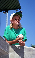 A young Boston Red Sox fan waits for autographs during Spring Training 1993 at City of Palms Park in Fort Myers, Florida.  (MJA/Four Seam Images)