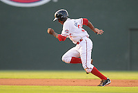 Center fielder Felix Sanchez (34) of the Greenville Drive steals third base in the first inning of a game on July 18, 2011, at Fluor Field at the West End in Greenville, South Carolina. Sanchez also stole second base during the inning, but was stranded at third. Rome won, 7-3. (Tom Priddy/Four Seam Images)