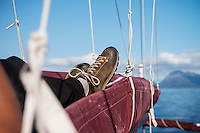 Morning nap in the sails while sailing along the coast of Vesterålen, Norway