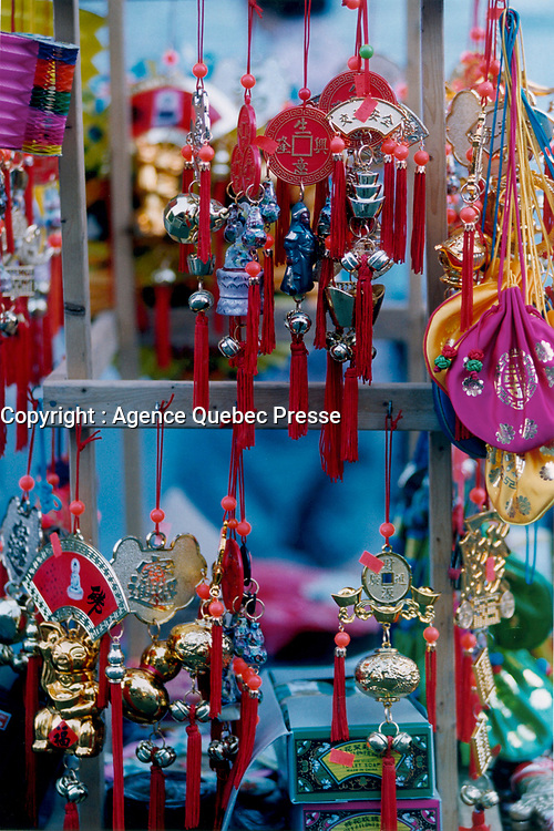 July 1995 file photo, Montreal, Quebec, Canada<br /> <br /> Various ornaments and gifts are displayed in front of a store in Montreal's Chinatown.<br />  <br /> <br /> Mandatory Credit: Photo by Pierre Roussel- Images Distribution. (©) Copyright by Pierre Roussel <br /> ON SPEC<br /> NOTE 8x10 print scanned AND,saved in Adobe 1998 RGB.