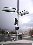 Street signs swing almost horizontally in the wind storm Friday. Dozens of homes and businesses with roof, fence and tree damage are seen in the Ranchos area of Gardnerville, Nev., on Friday, Feb. 6, 2015. A powerful wind and rain storm will continue to move through the area over the next few days. <br /> Photo by Cathleen Allison