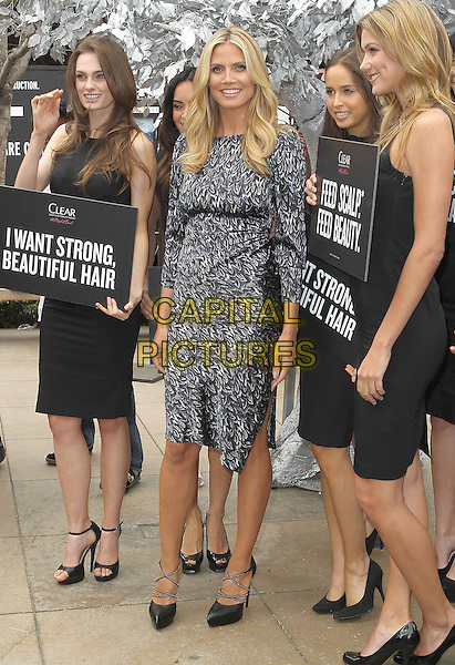 "Heidi Klum.Heidi Klum Kicks Off The ""Right End"" Hair Revolution With Clear Scalp & Hair Beauty Therapy held at The Grove, Los Angeles, California, USA..May 1st, 2013.full length black white grey gray pattern dress dress  signs i want strong beautiful hair.CAP/ADM/KB.©Kevan Brooks/AdMedia/Capital Pictures"