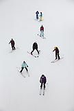USA, Colorado, Aspen, skiers under the Exhibition Ski Lift, Aspen Highlands Ski Resort