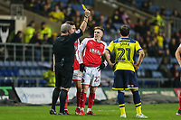 Ashley Hunter of Fleetwood Town (22) is booked during the Sky Bet League 1 match between Oxford United and Fleetwood Town at the Kassam Stadium, Oxford, England on 10 April 2018. Photo by David Horn.