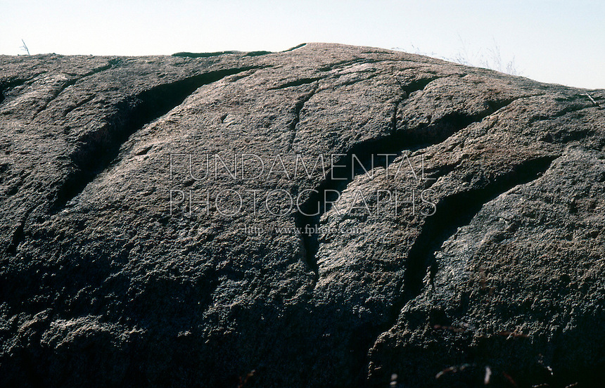 GLACIAL EROSION<br /> Chatter Marks, Bear Mountain<br /> Indentations left in bedrock by the plucking action of the glacial ice. Chatter marks indicate the direction of ice flow.