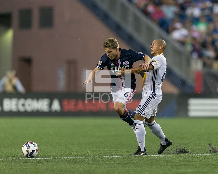 Foxborough, Massachusetts - July 22, 2017: First half action. In a Major League Soccer (MLS) match, New England Revolution (blue/white) vs LA Galaxy (white), at Gillette Stadium.