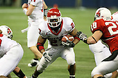 January 5th, 2008:  Rutgers running back Ray Rice (27) finds a hole as Ball State defender Mike Dorulla (28) closes in during the second quarter of the International Bowl at the Rogers Centre in Toronto, Ontario Canada...Rutgers defeated Ball State 52-30.  ..Photo By:  Mike Janes Photography
