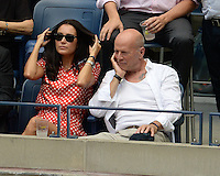 FLUSHING NY- SEPTEMBER 09: Bruce Willis and Emma Heming seen watching Novak Djokovic Vs Gael Monfils during the mens semi finals on Arthur Ashe Stadium at the USTA Billie Jean King National Tennis Center on September 9, 2016 in Flushing Queens. Credit: mpi04/MediaPunch