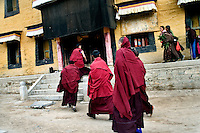 Monks walk to a prayer hall at Labrang Monastery in Xiahe, Gansu, China.  Xiahe, home of the Labrang Monastery, is an important site for Tibetan Buddhists.  The population of the town is divided between ethnic Tibetans, Muslims, and Han Chinese.
