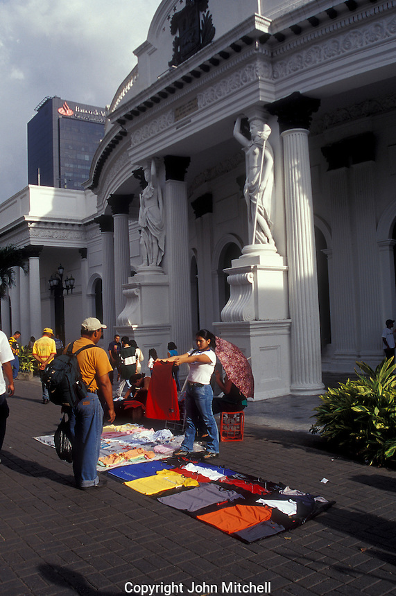 Sidewalk vendor selling clothing in front of the National Capitol in downtown Caracas, Venezuela