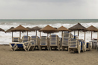 Bad day for sun worshippers - beach, Estepona, Spain, April, 2017, 201704203423<br /> <br /> Copyright Image from Victor Patterson, 54 Dorchester Park, <br /> Belfast, UK, BT9 6RJ<br /> <br /> t1: +44 28 9066 1296 (from Rep of Ireland 048 9066 1296)<br /> t2: +44 28 9002 2446 (from Rep of Ireland 048 9002 2446)<br /> m: +44 7802 353836<br /> <br /> e1: victorpatterson@me.com<br /> e2: victorpatterson@gmail.com<br /> <br /> www.victorpatterson.com<br /> <br /> Please see my Terms and Conditions of Use at www.victorpatterson.com. It is IMPORTANT that you familiarise yourself with them.<br /> <br /> Images used on the Internet must be visibly watermarked i.e. © Victor Patterson within the body of the image and copyright metadata must not be deleted. Images used on the Internet have a size restriction of 4kbs and will be chargeable at current NUJ rates unless agreed otherwise.<br /> <br /> This image is only available for the use of the download recipient i.e. television station, newspaper, magazine, book publisher, etc, and must not be passed on to any third party. It is also downloaded on condition that each and every usage is notified within 7 days to victorpatterson@me.com<br /> <br /> The right of Victor Patterson to be identified as the author is asserted in accordance with The Copyright Designs And Patents Act (1988).